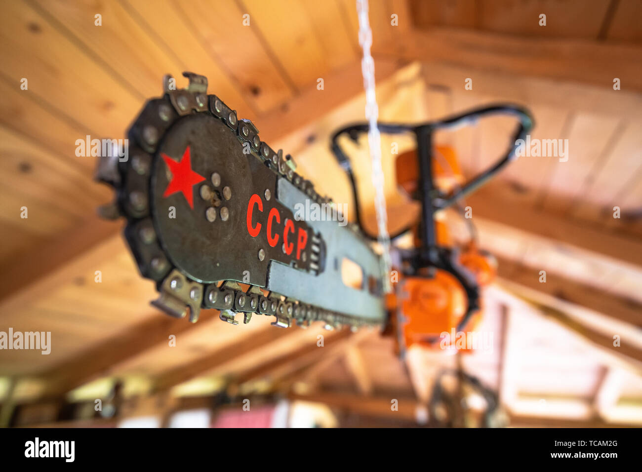 Soviet made chainsaw blade with USSR or CCCP and red star sign, historic soviet gear - Stock Image