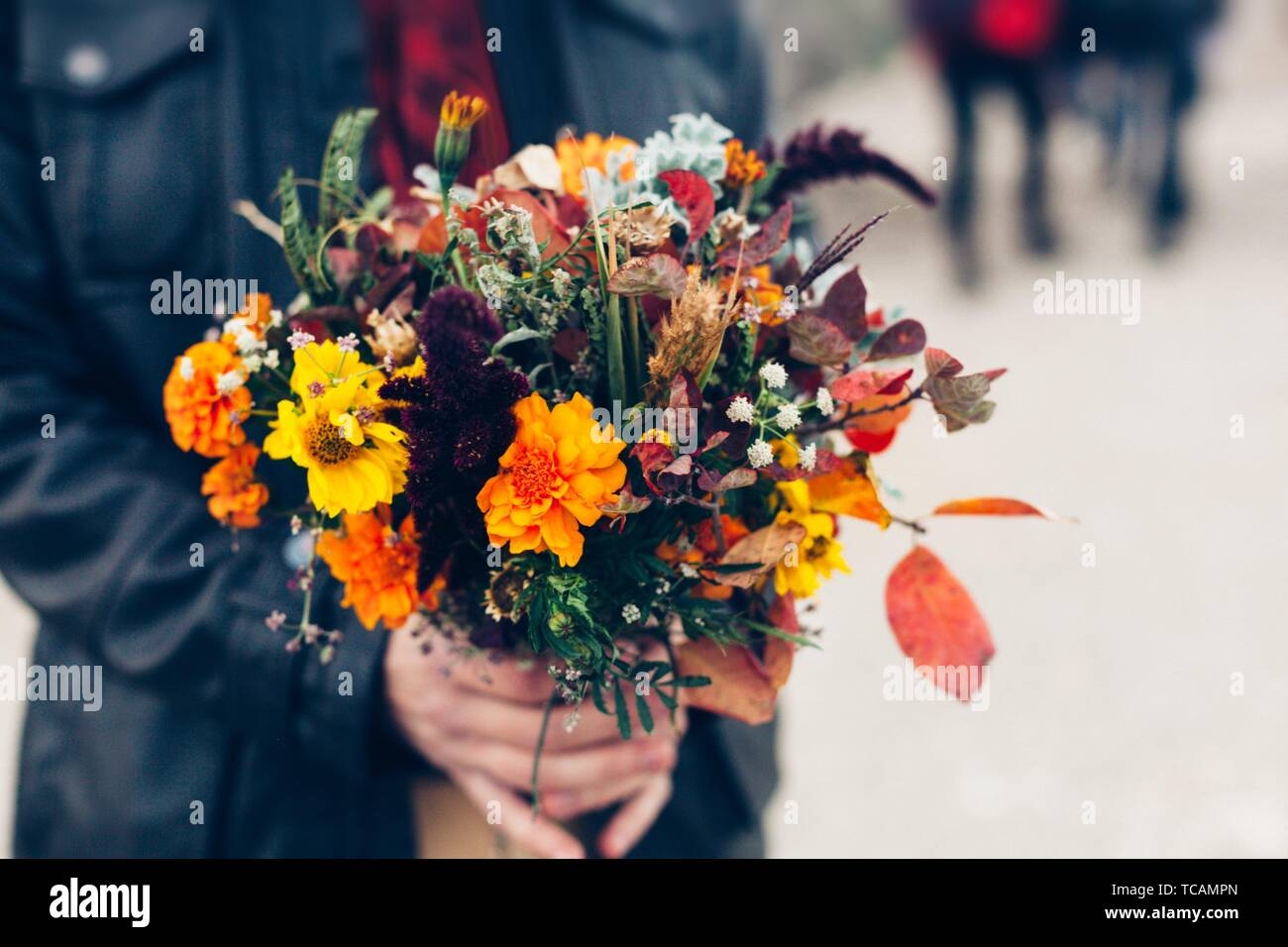 Wedding Bouquet In A Bright Autumn Style In The Hands Of The Groom Marigold Flowers Design Stock Photo Alamy
