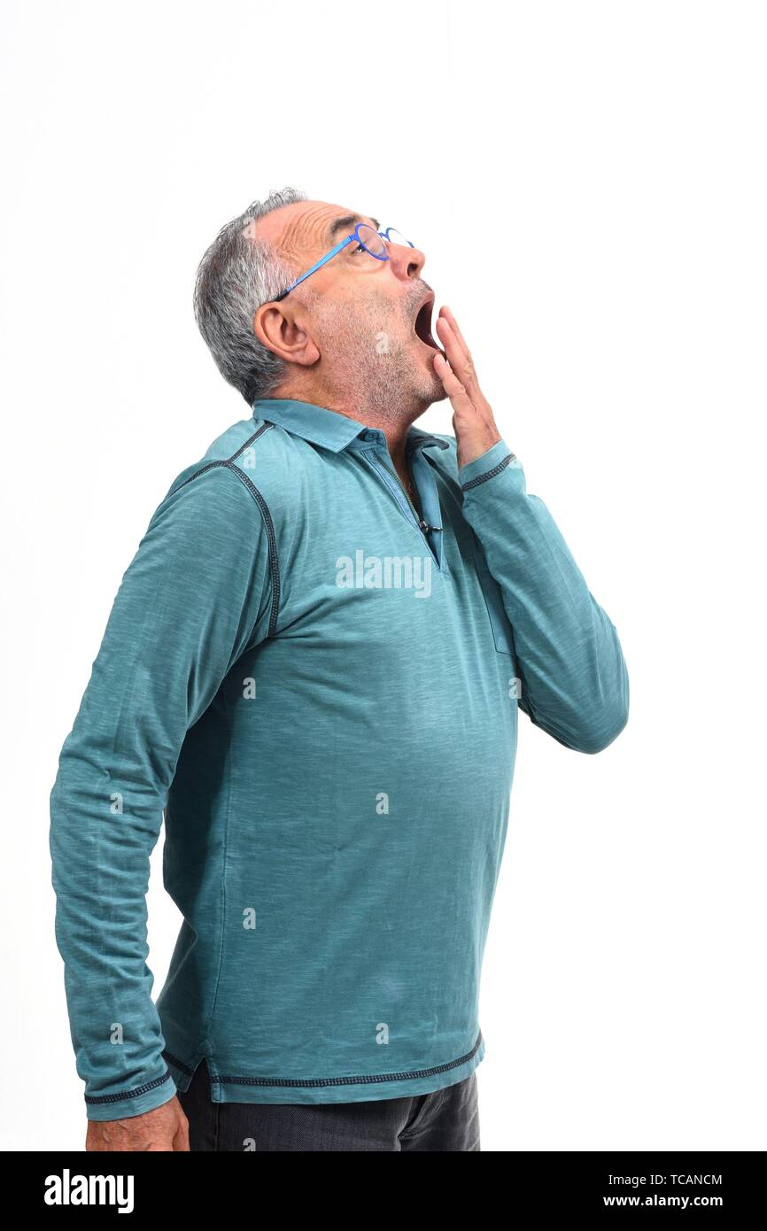 man yawning on white background. - Stock Image