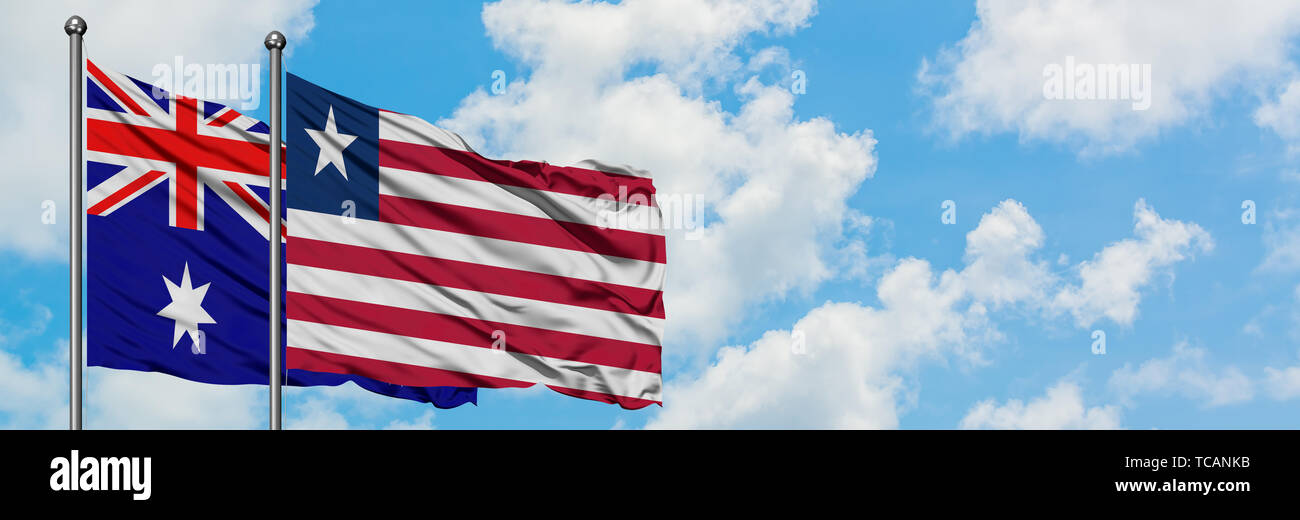 Australia and Liberia flag waving in the wind against white