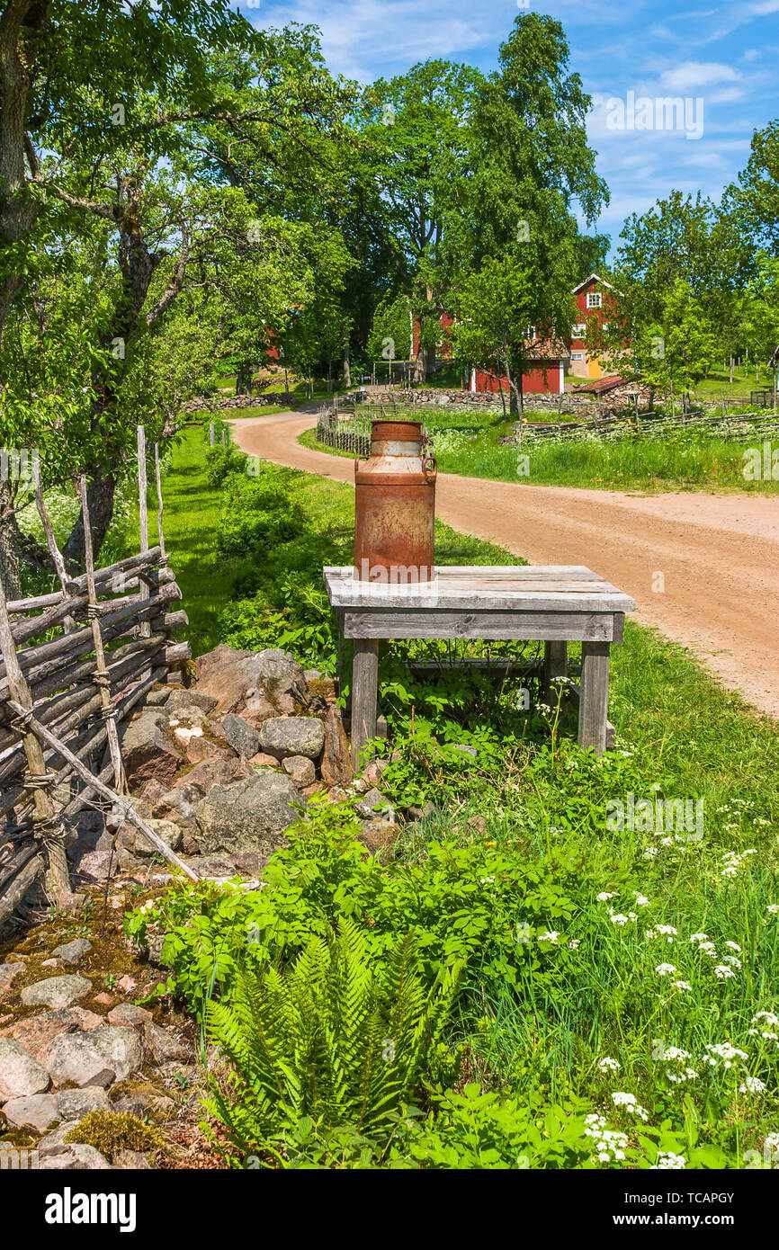 Milk pot on a table at a country road - Stock Image