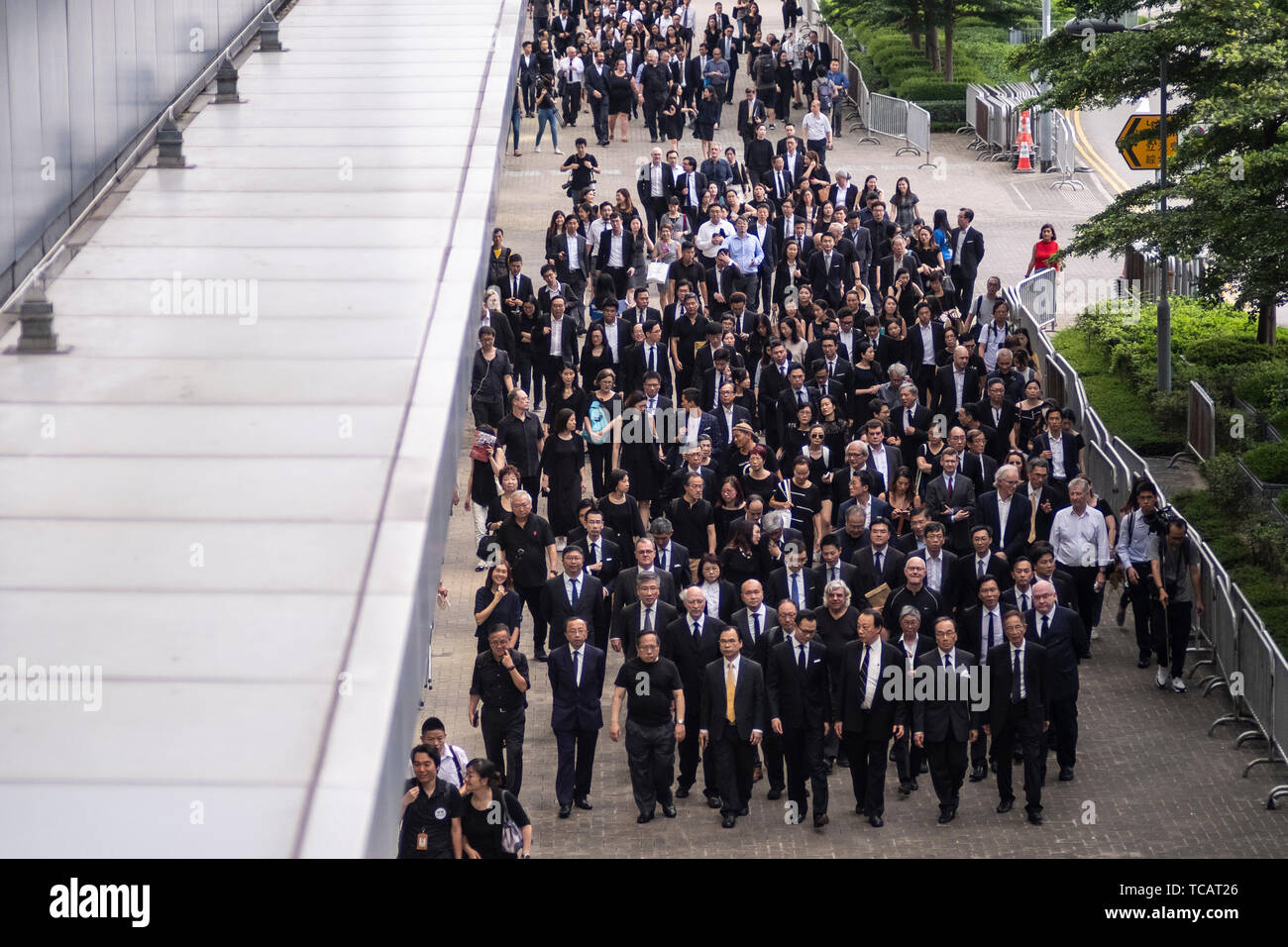 Hundreds of lawyers and legal professionals dress in black take part during the silent march against the extradition bill from the Court of Final Appeal to the Central Government Complex in Hong Kong.  Critics fear any extradition agreement could leave both business figures and dissidents in Hong Kong vulnerable to China's politicized courts, fatally undermining a business hub that has thrived off its reputation for a transparent and independent judiciary. - Stock Image