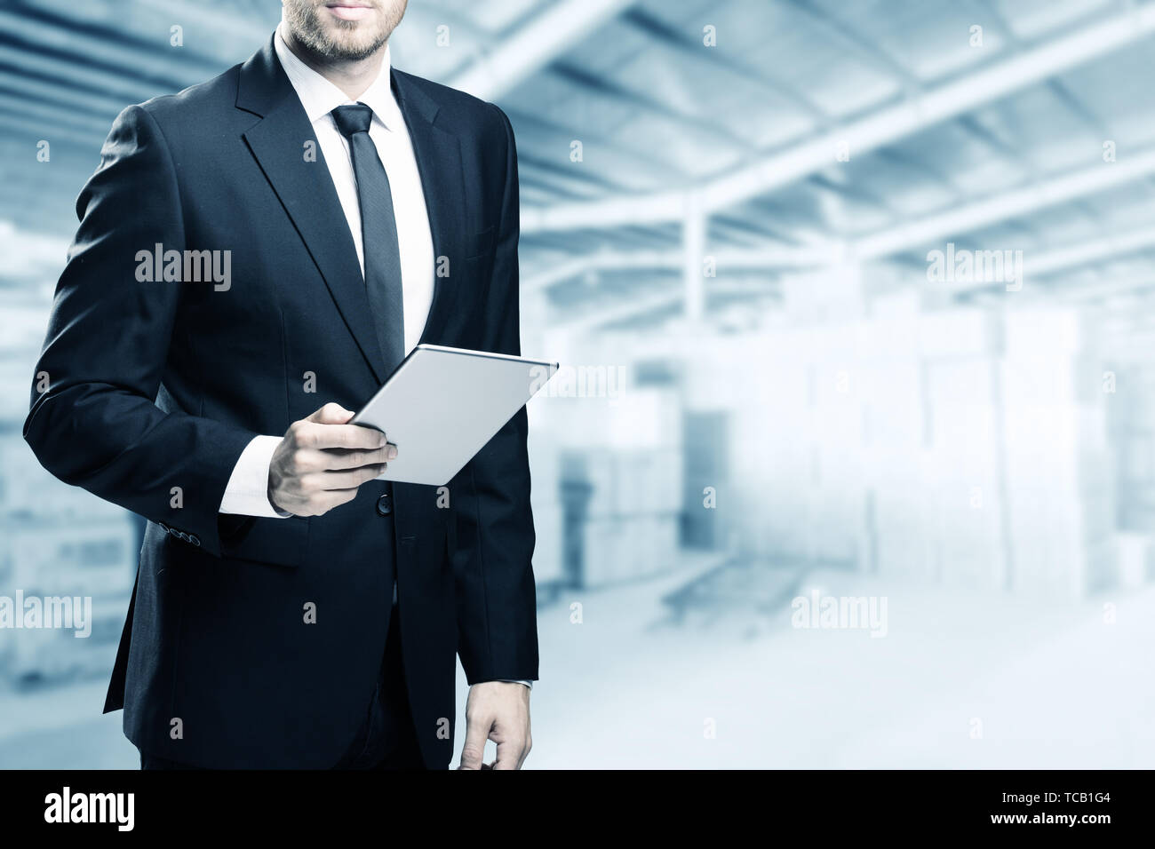 448e91a7a4ea4 double exposure of businessman with tablet on building background ...