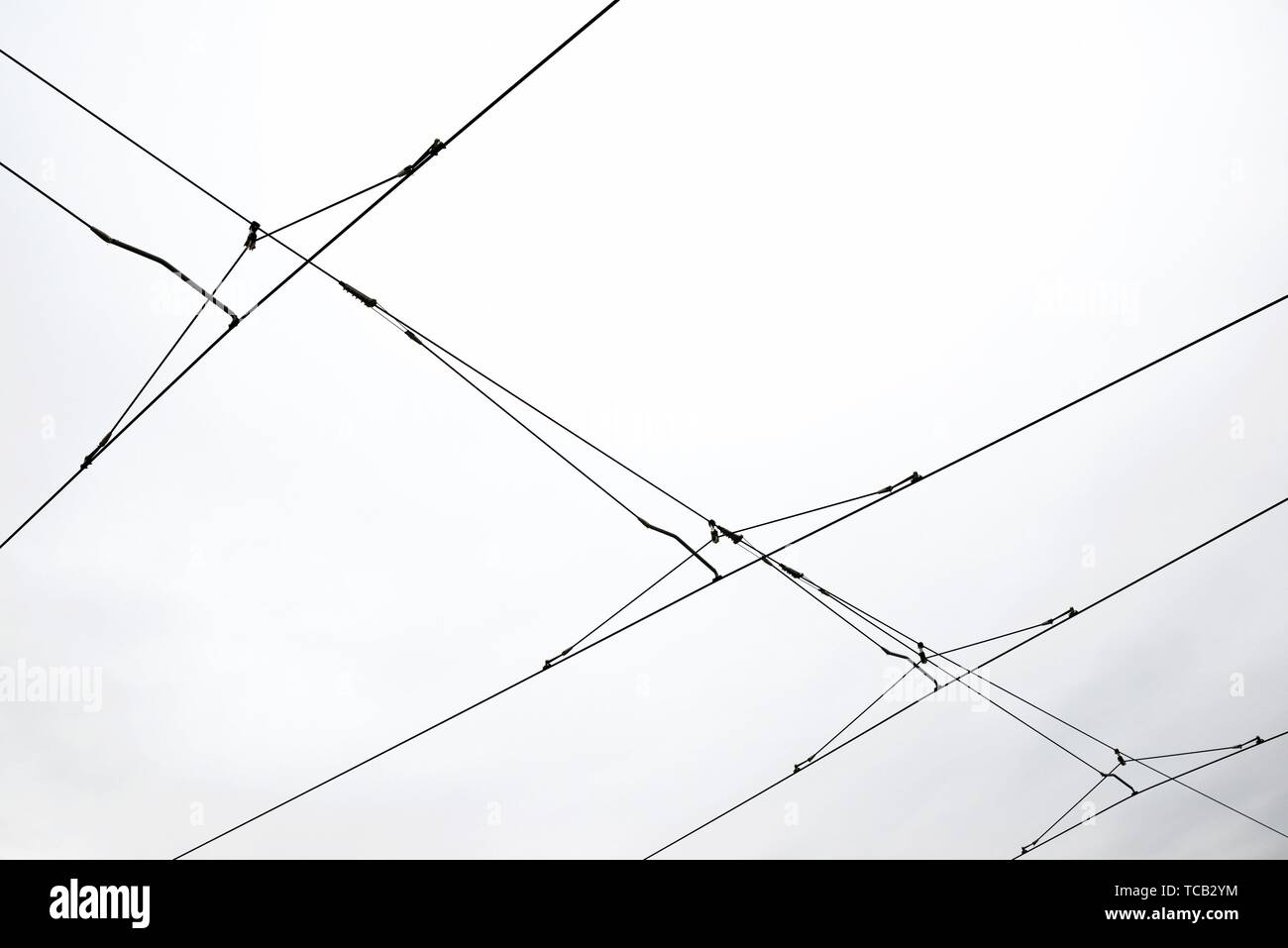 Detail of a catenary and stormy sky. Stock Photo