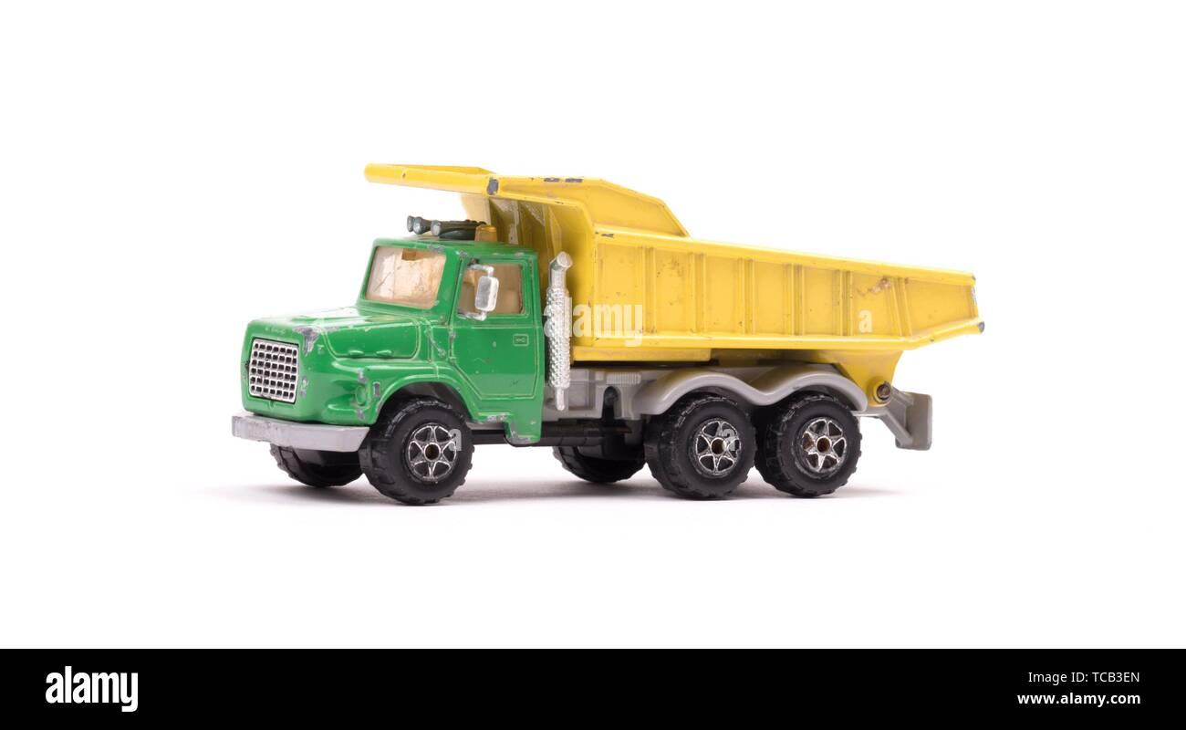 Dump truck toy isolated on white background. - Stock Image