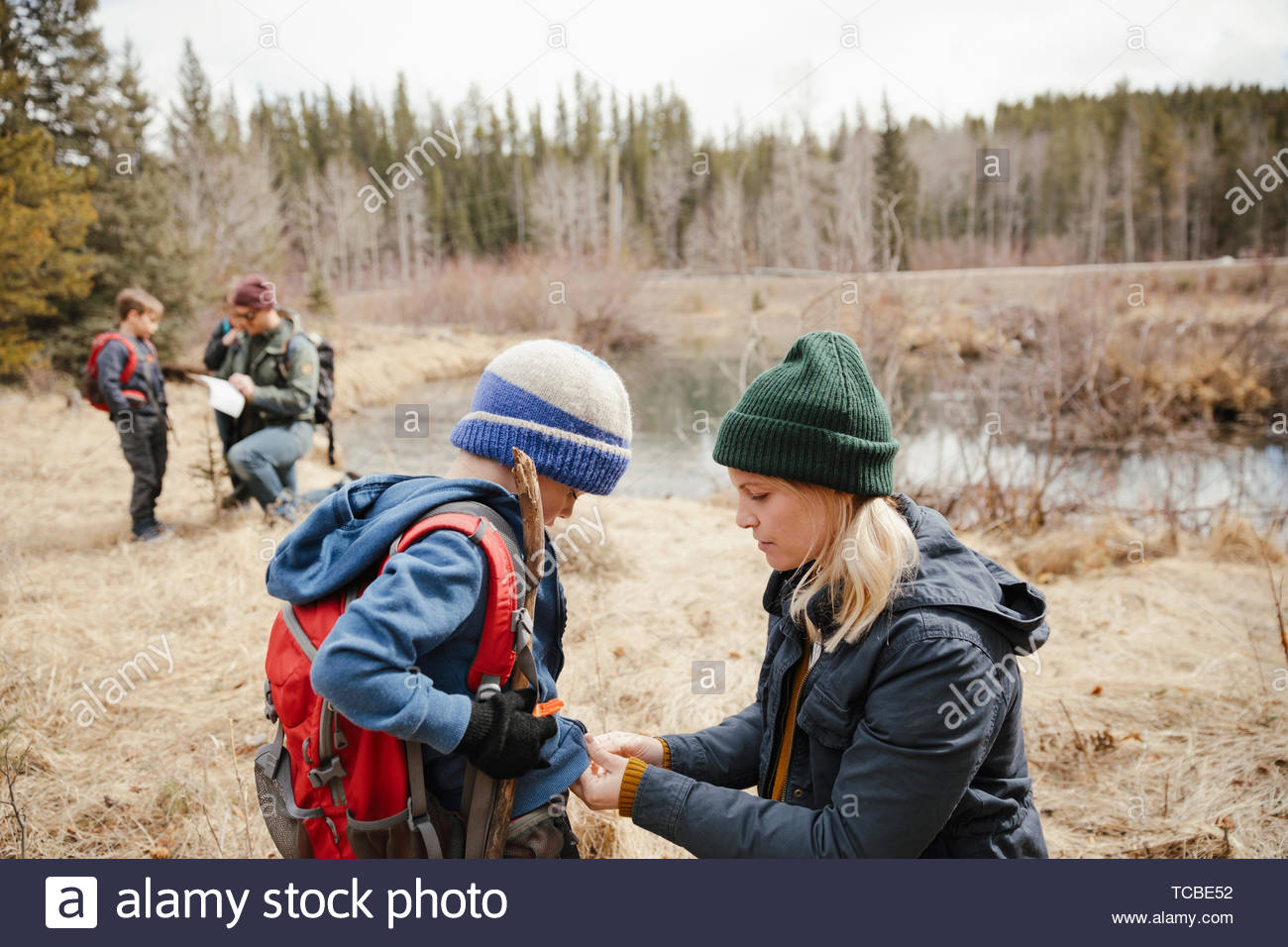 Family hiking in woods - Stock Image
