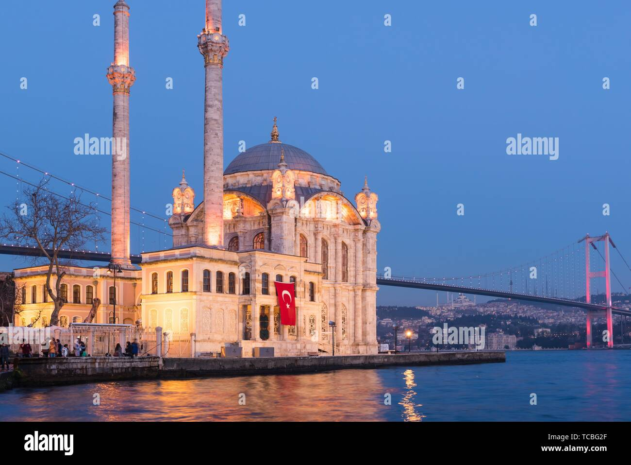 Exterior view of Ortakoy Mosque with15 July Martyrs Bridge or unofficially Bosphorus Bridge also called First Bridge over bosphorus in Stock Photo
