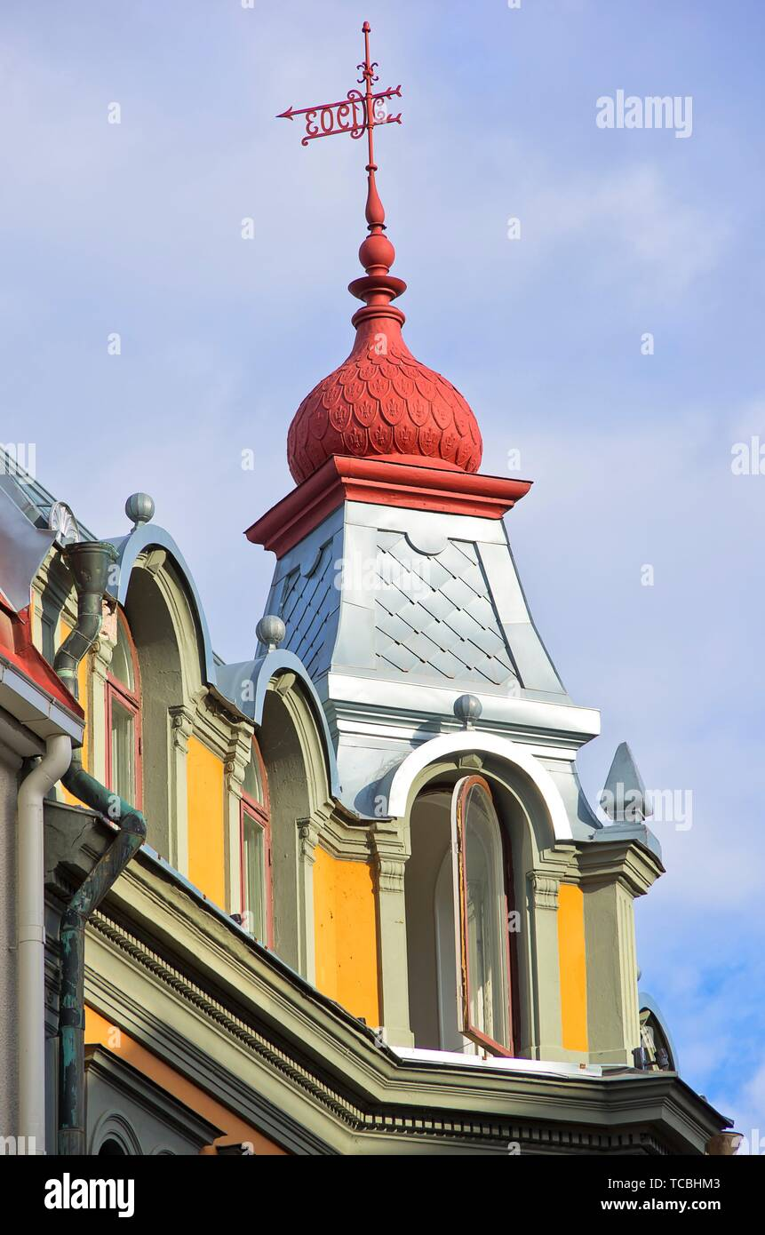 Turret on the roof of an historic urban apartment building, Kalmar, Sweden. - Stock Image