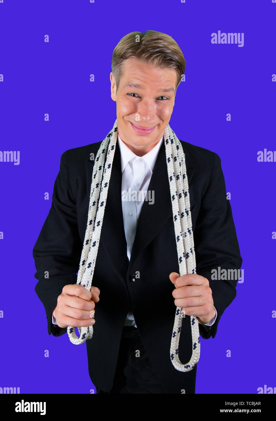 Elegant and happy juggler with juggling rope. - Stock Image