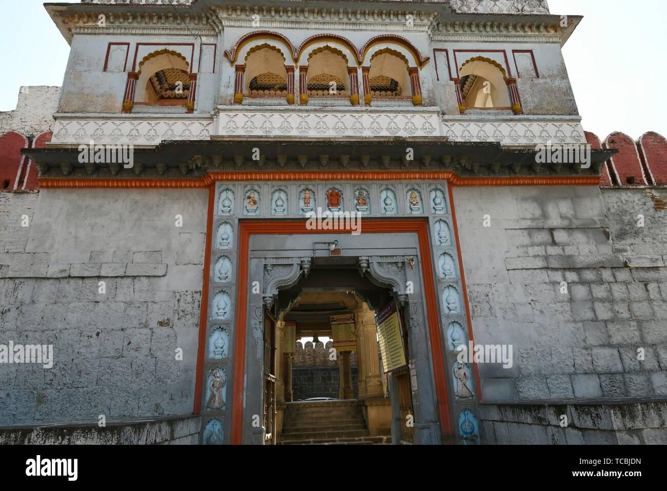 Stone masonry fortified wall and gate at Vitthal Temple, Palashi, Parner, Ahmednagar. - Stock Image
