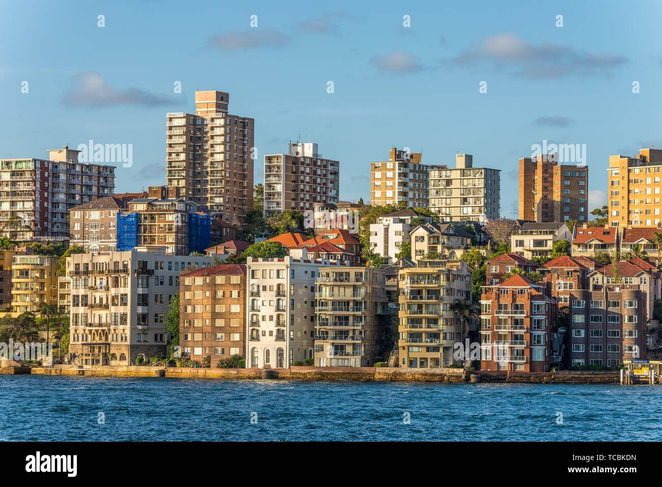 Beautiful part of Sydney Kirribilli with houses and ocean coastline, suburb of Sydney Australia. As the sun sets and casts warm golden color. - Stock Image