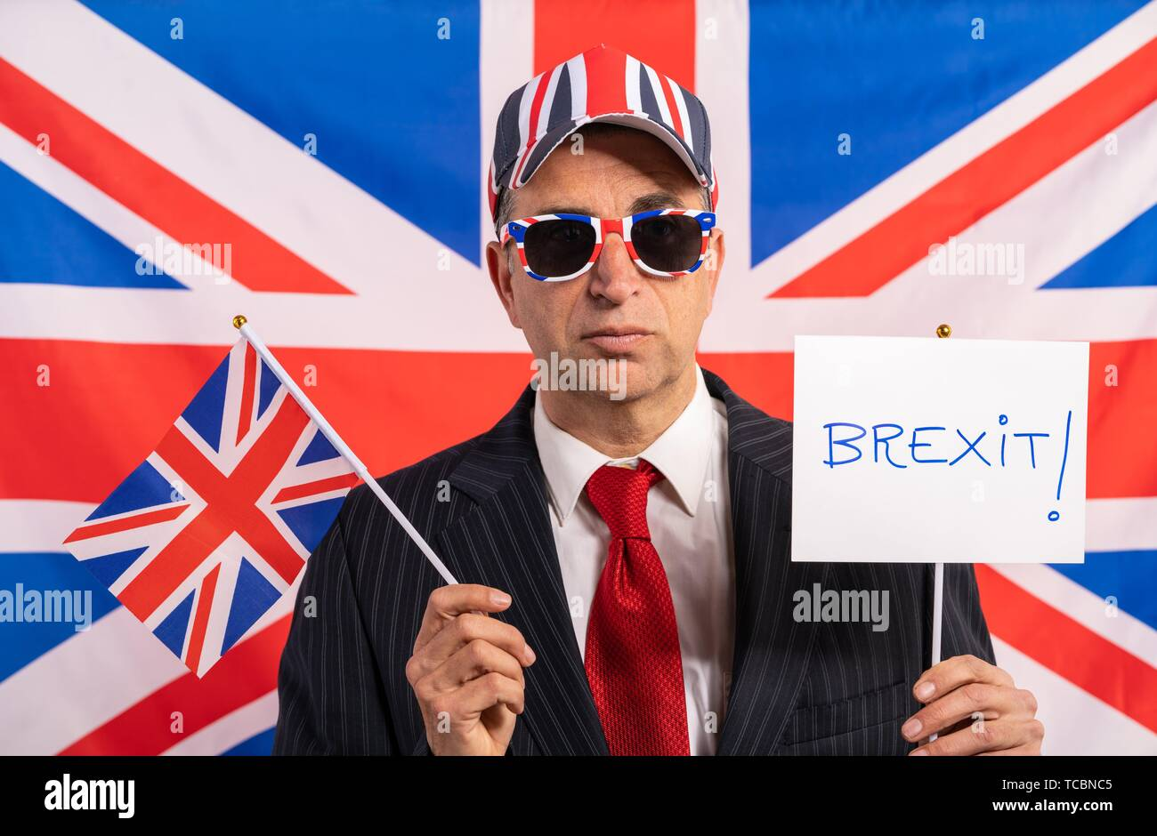 British male businessman with Brexit banner and UK flag. - Stock Image
