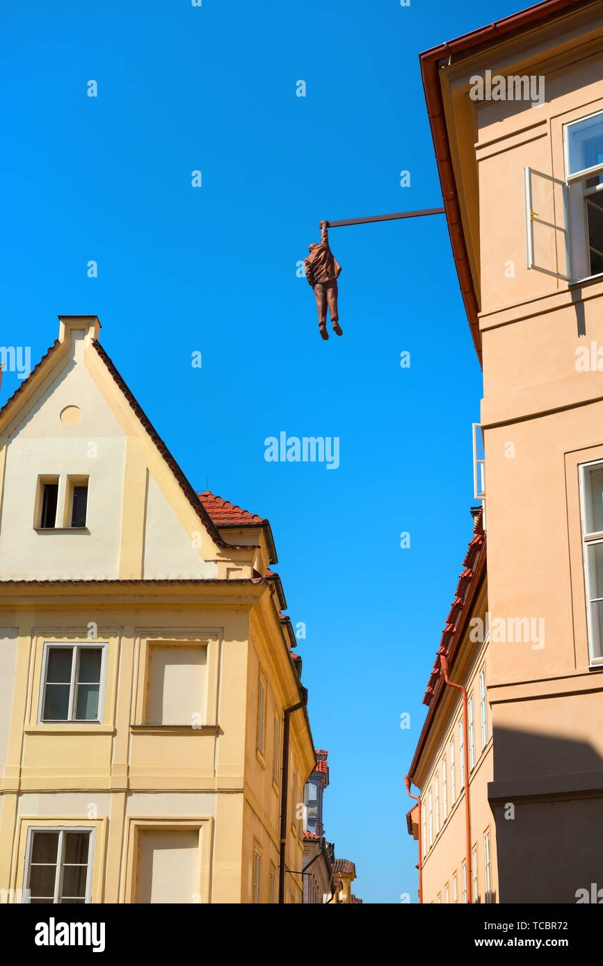 PRAGUE, CZECH REPUBLIC - July, 2018: Sculpture of the psychoanalyst Sigmund Freud hanging by a hand called Man Hanging Out created by the artist - Stock Image