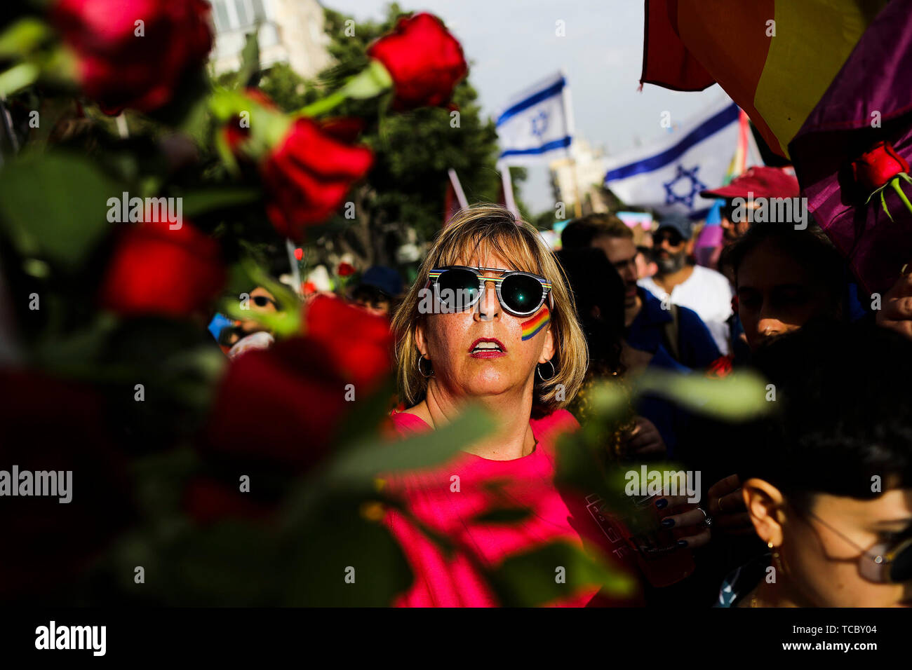 Jerusalem. 06th June, 2019. Participants of Jerusalem's annual Gay Pride Parade, put flowers to commemorate Shira Banki, who was stabbed to death by an ultra-Orthodox Jew during last year's Gay Pride parade. Credit: Ilia Yefimovich/dpa/Alamy Live News - Stock Image