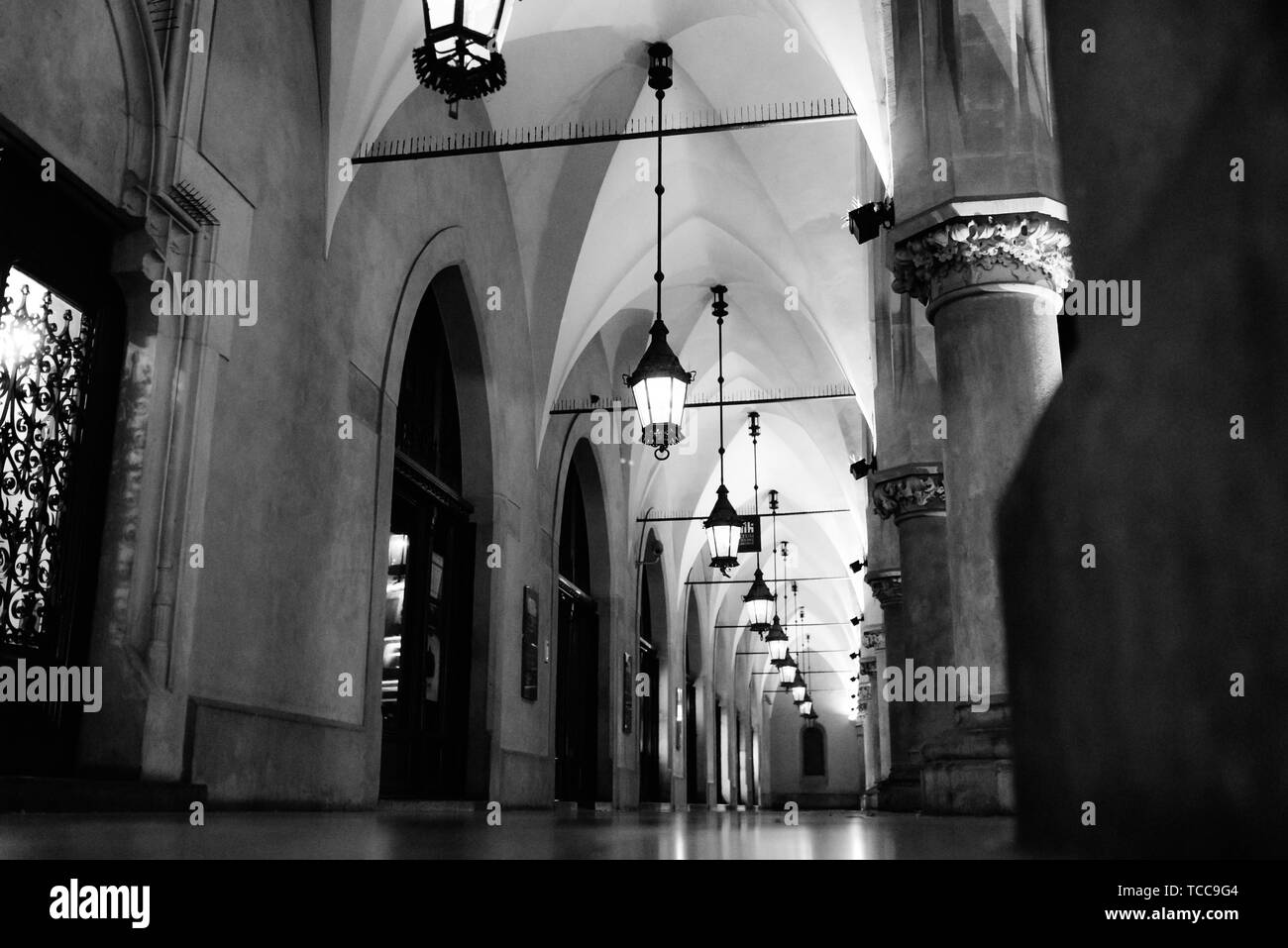 Night old commercial area of Krakow in the lights of street lamps. Old Europe. - Stock Image