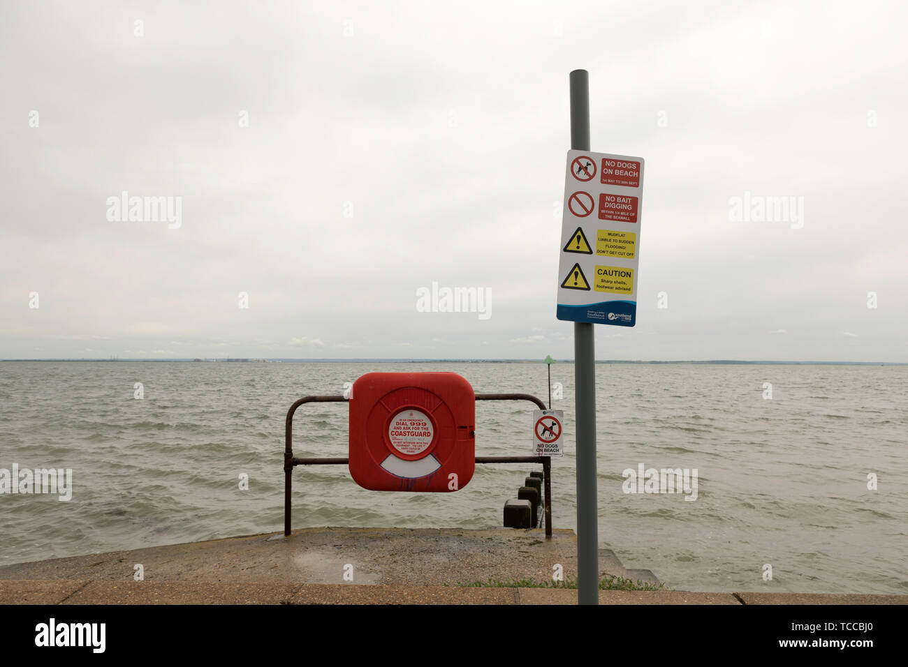 Southend on Sea, UK. 5th June, 2019. Lifebuoy ring and warnings sign post. - Stock Image
