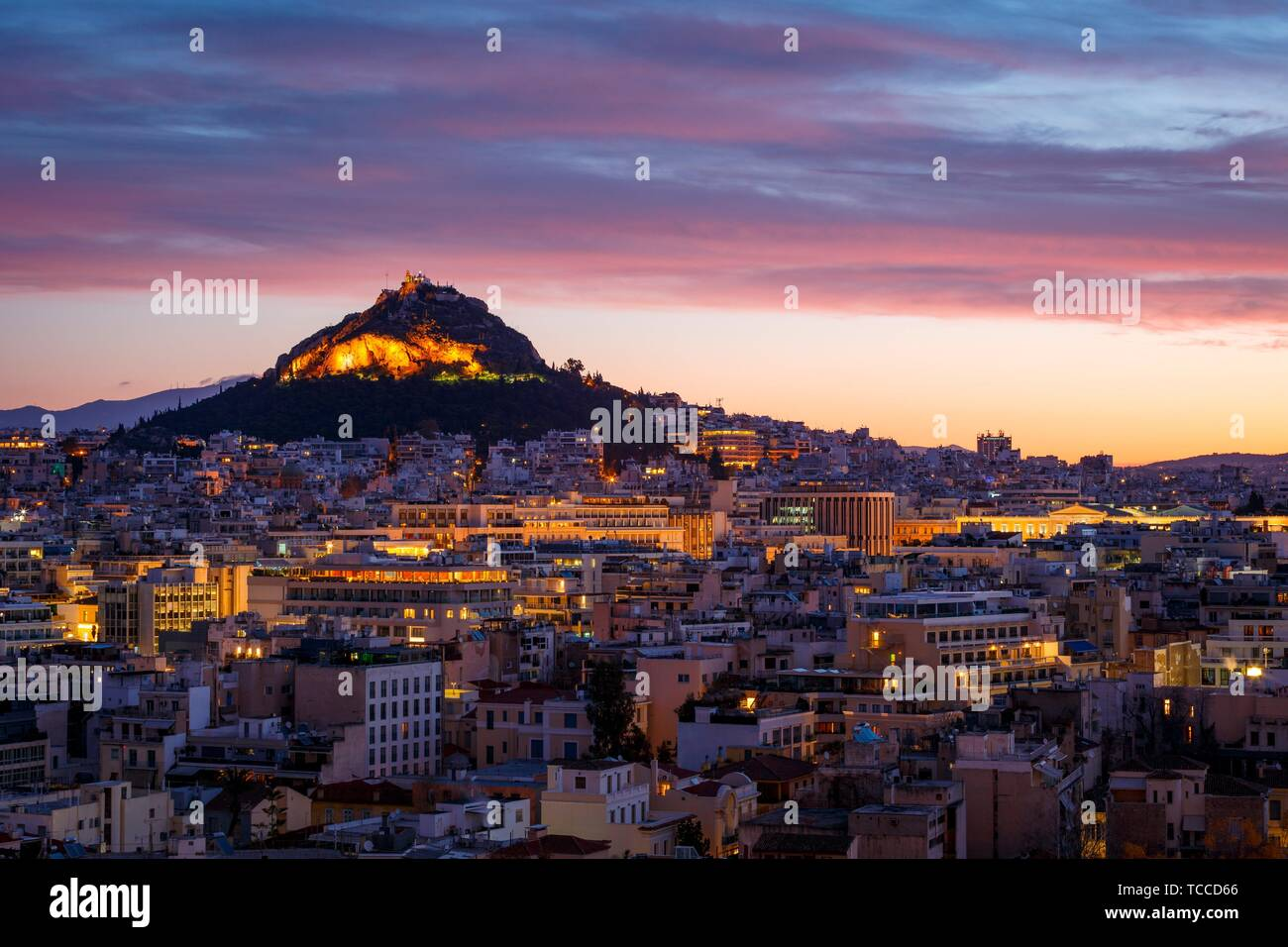View of Lycabettus hill from Anafiotika neighborhood in the old town of Athens, Greece.. Stock Photo