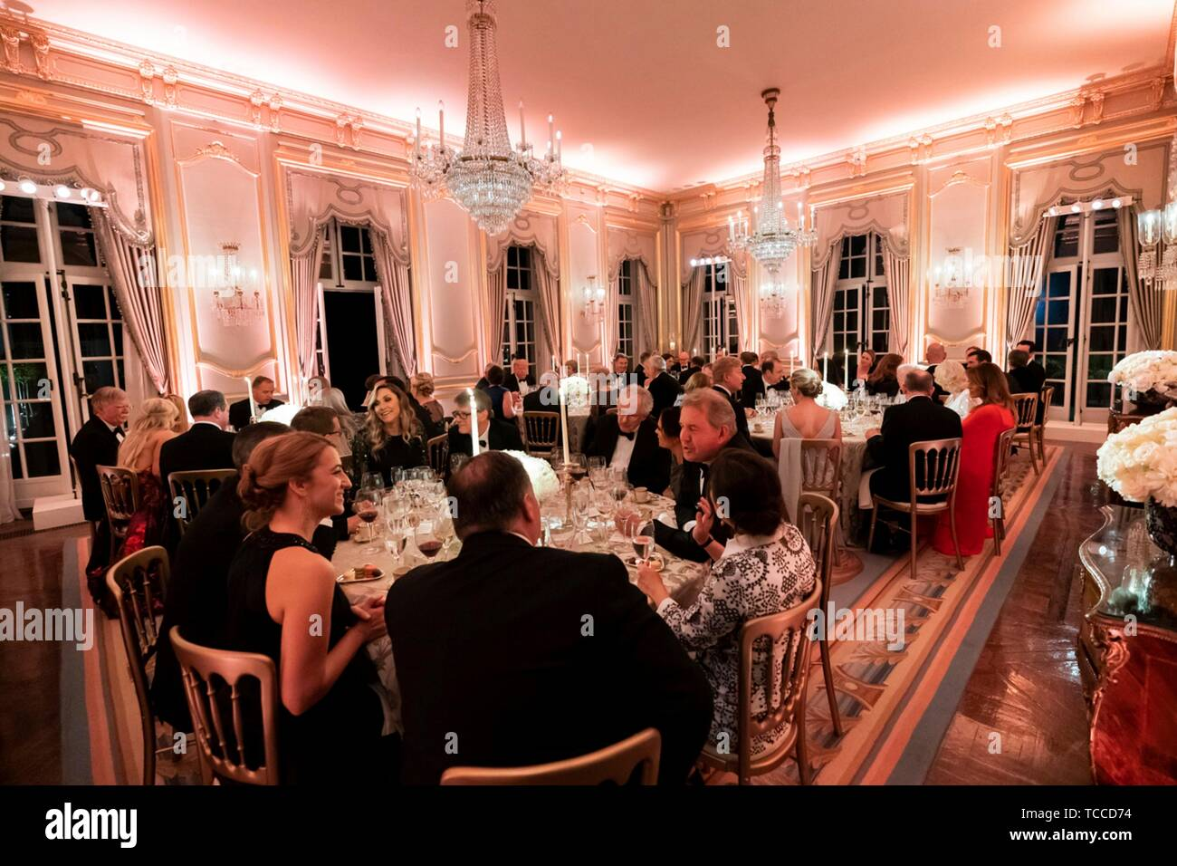 Guests enjoy a gala dinner hosted by U.S President Donald Trump and First Lady Melania Trump at Winfield House June 4, 2019 in London, England. Stock Photo