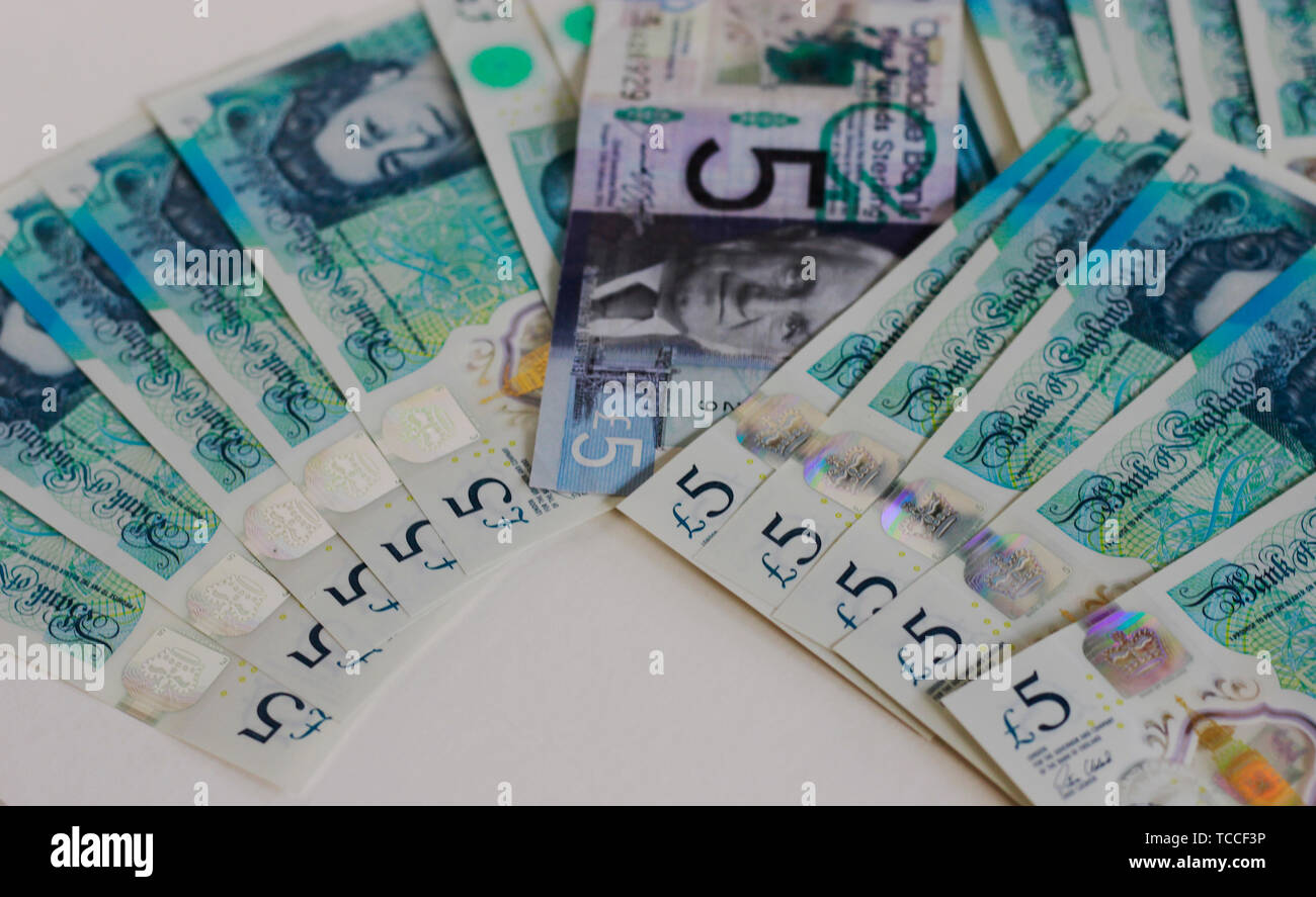 Five pound banknotes on a white background, Bank of Scotland £5 note, a fiver, banknote of the pound sterling, May 2019, UK. - Stock Image
