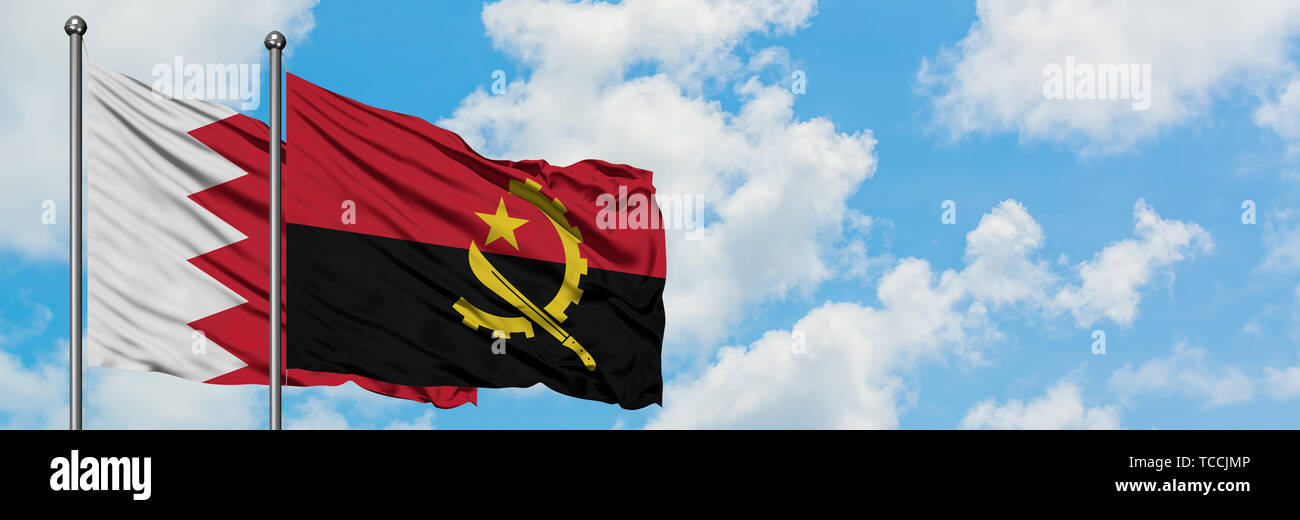 Bahrain and Angola flag waving in the wind against white cloudy blue sky together. Diplomacy concept, international relations. - Stock Image