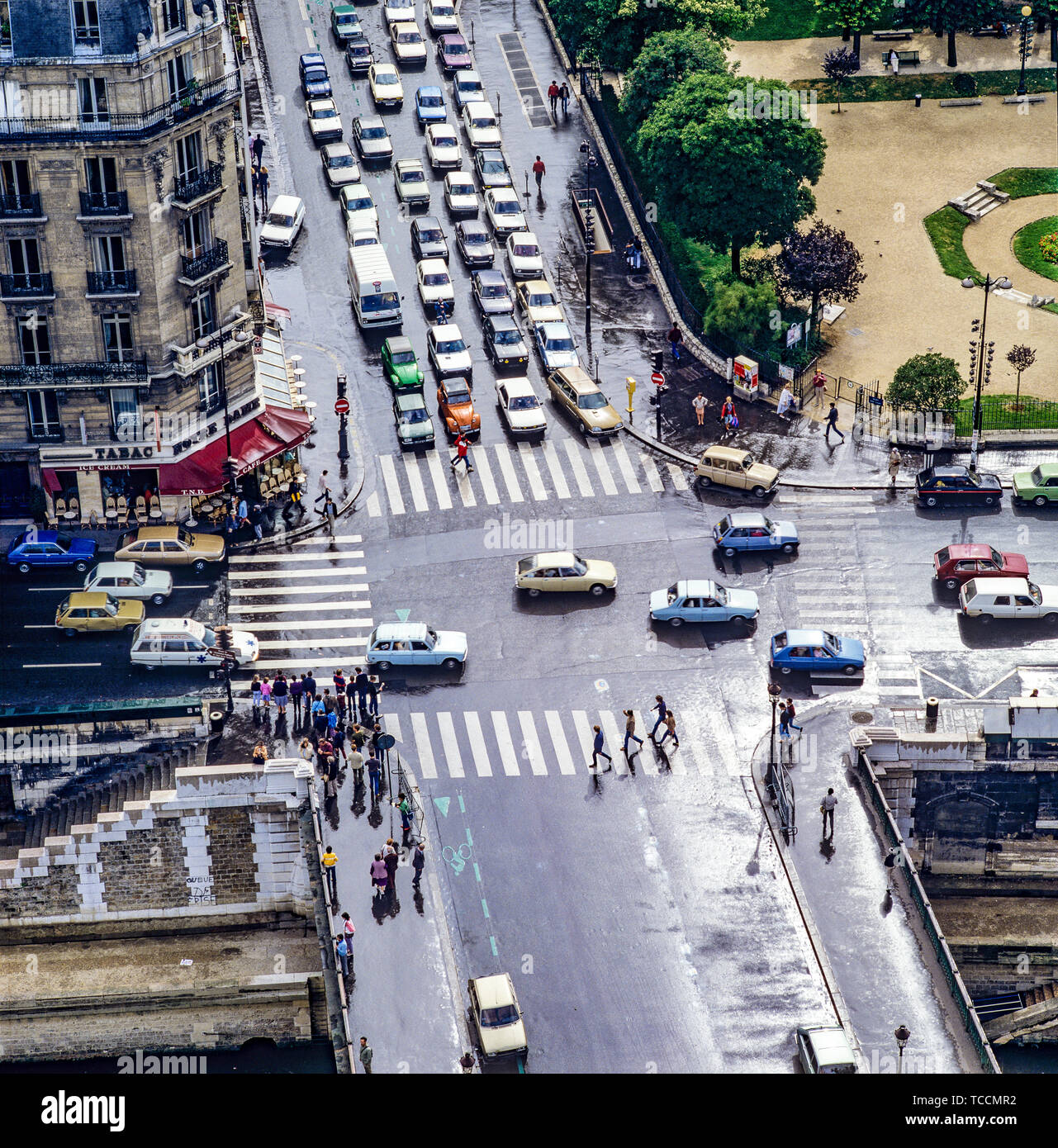 Overview of streets crossing from Notre-Dame de Paris cathedral, pedestrian crossings, cars traffic, Pont Au Double bridge, Paris, France, Europe, - Stock Image