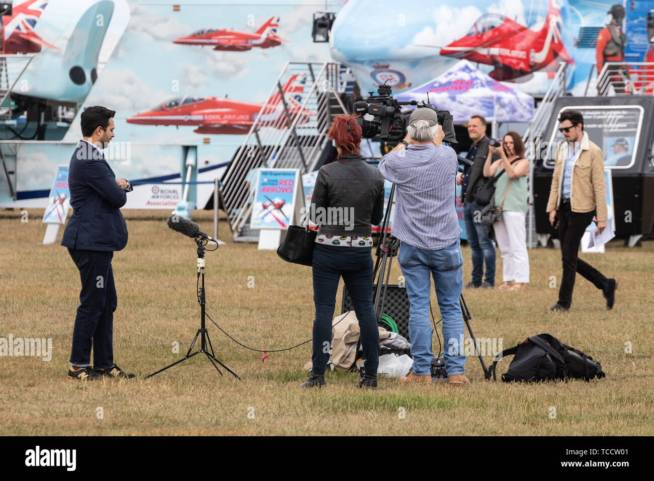 A camera crew setting up for a live broadcast Stock Photo