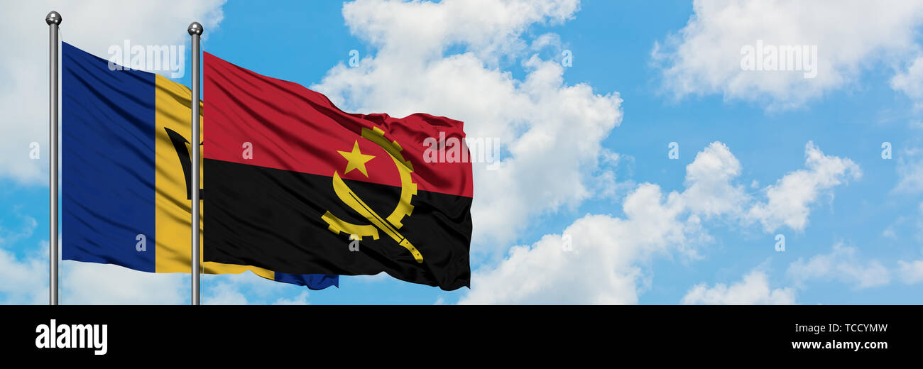 Barbados and Angola flag waving in the wind against white cloudy blue sky together. Diplomacy concept, international relations. - Stock Image