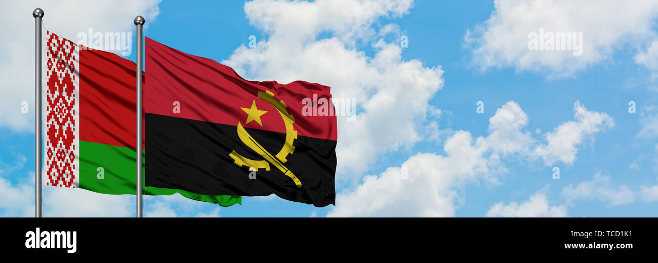 Belarus and Angola flag waving in the wind against white cloudy blue sky together. Diplomacy concept, international relations. Stock Photo