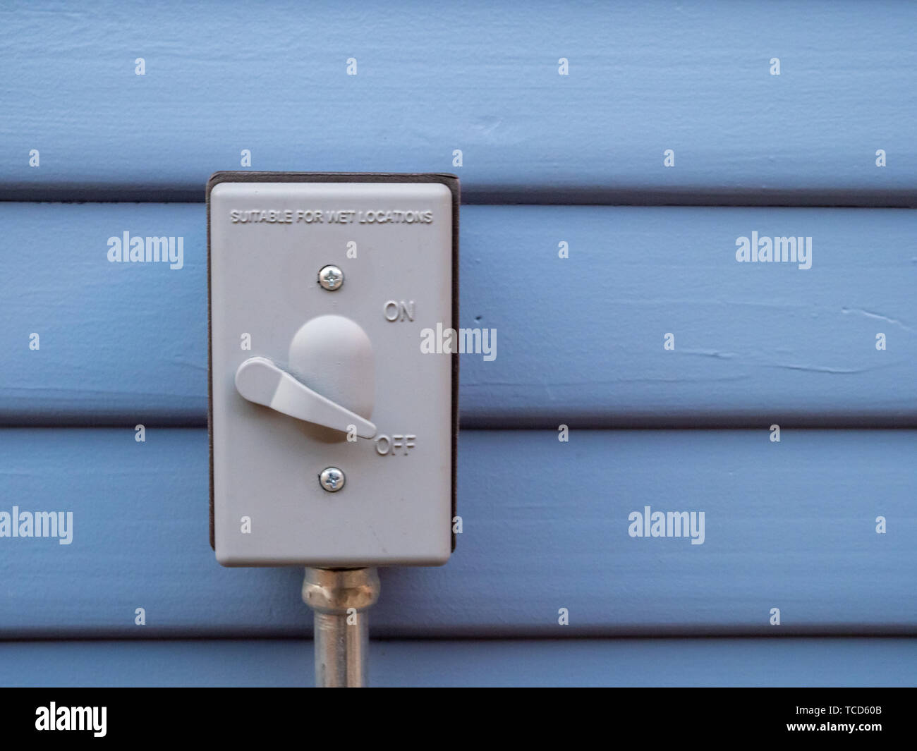 Outdoor heavy duty durable power switch attached to wall of home - Stock Image