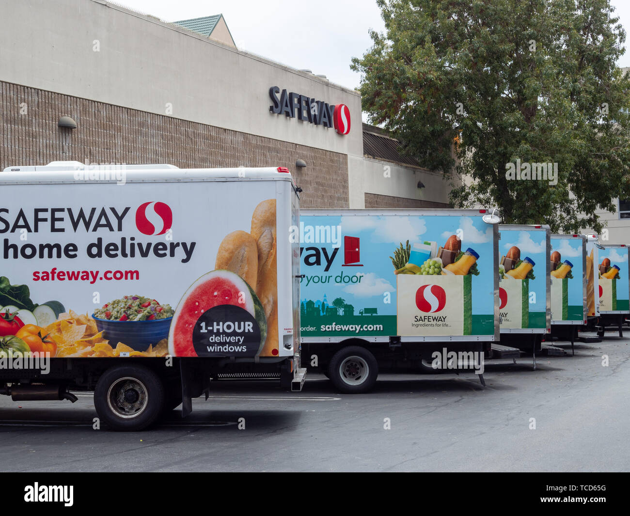 Fleet of Safeway home grocery delivery trucks outside of