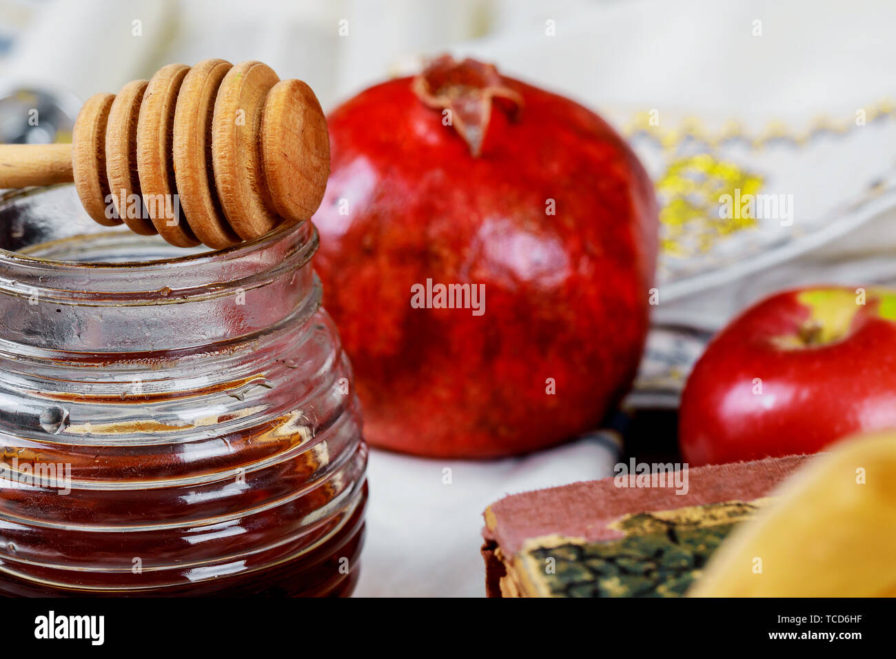 Honey, apple and pomegranate for traditional holiday symbols rosh hashanah jewesh holiday on wooden white background. - Stock Image