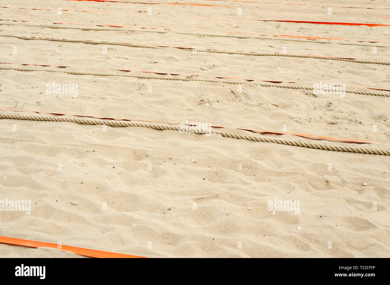 Prepared sand for sports on the beach. - Stock Image