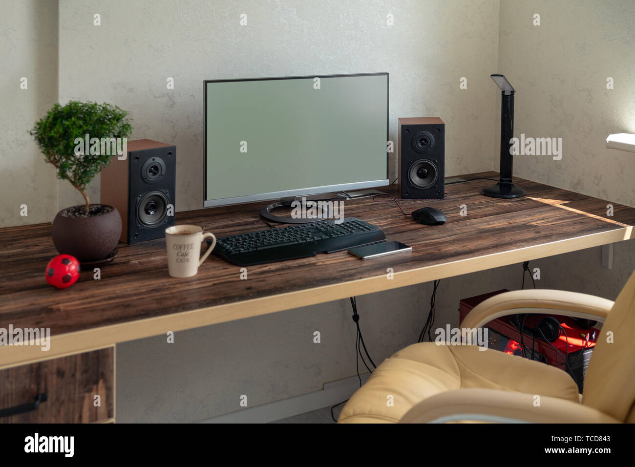 Empty Office With Large Desktop Computer Monitor Speakers And Bonsai On A Wooden Desk With Mobile Phone Stock Photo Alamy