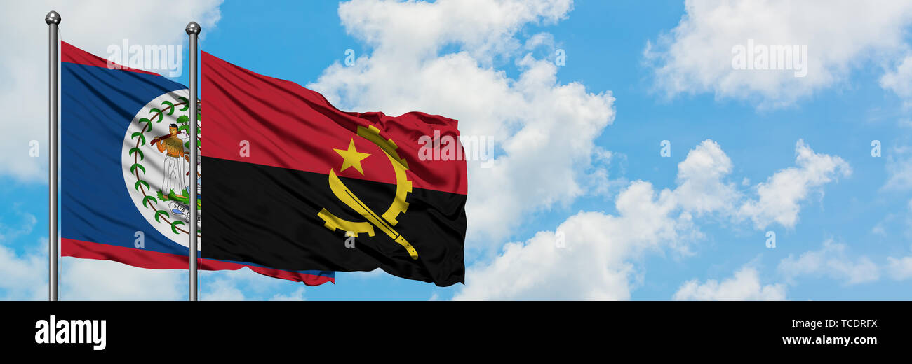 Belize and Angola flag waving in the wind against white cloudy blue sky together. Diplomacy concept, international relations. - Stock Image