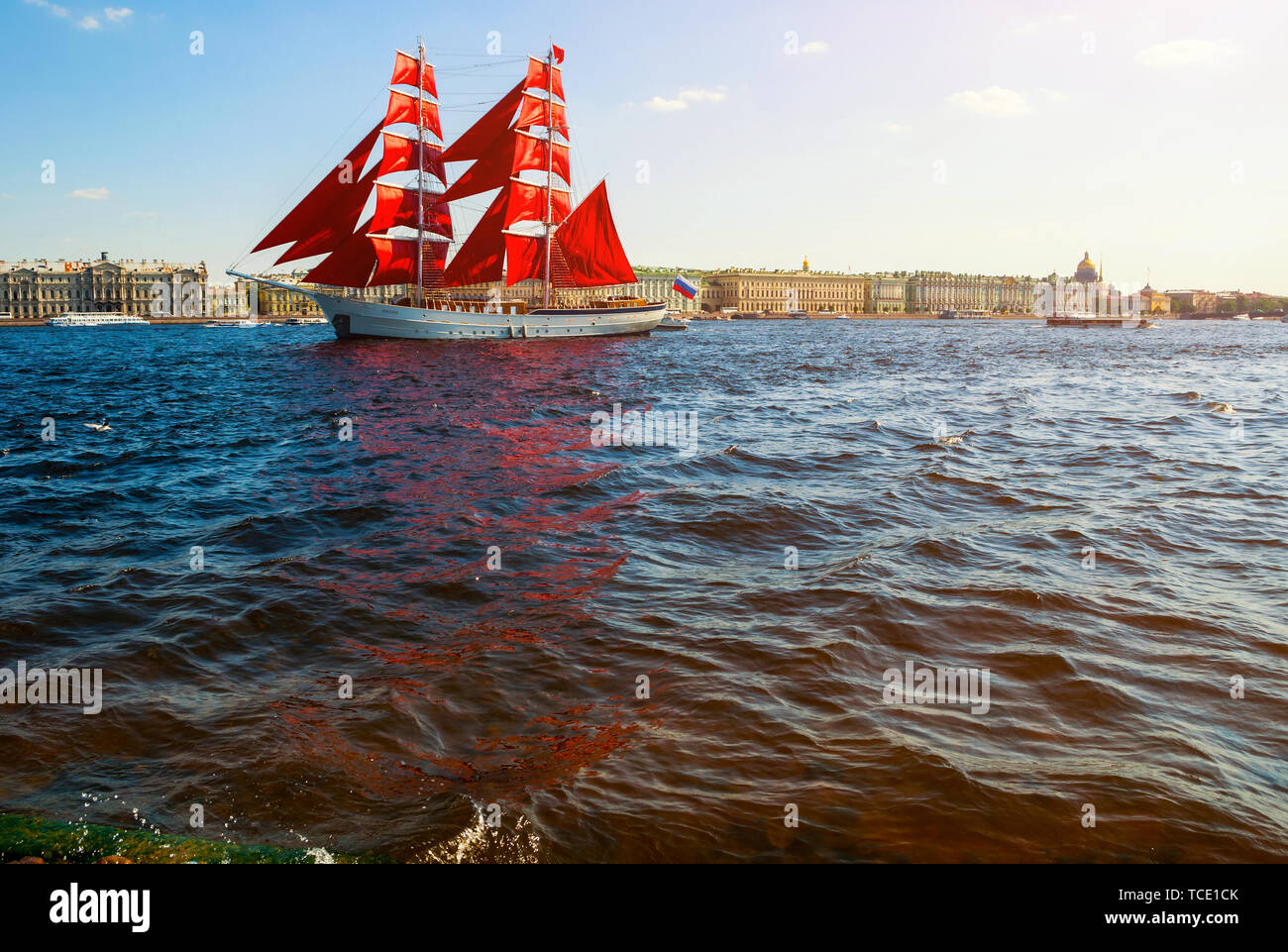 St Petersburg, Russia - June 6, 2019. Swedish brig Tre Kronor with Scarlet sails on the Neva river. Scarlet Sails is the Russian holiday of school gra Stock Photo