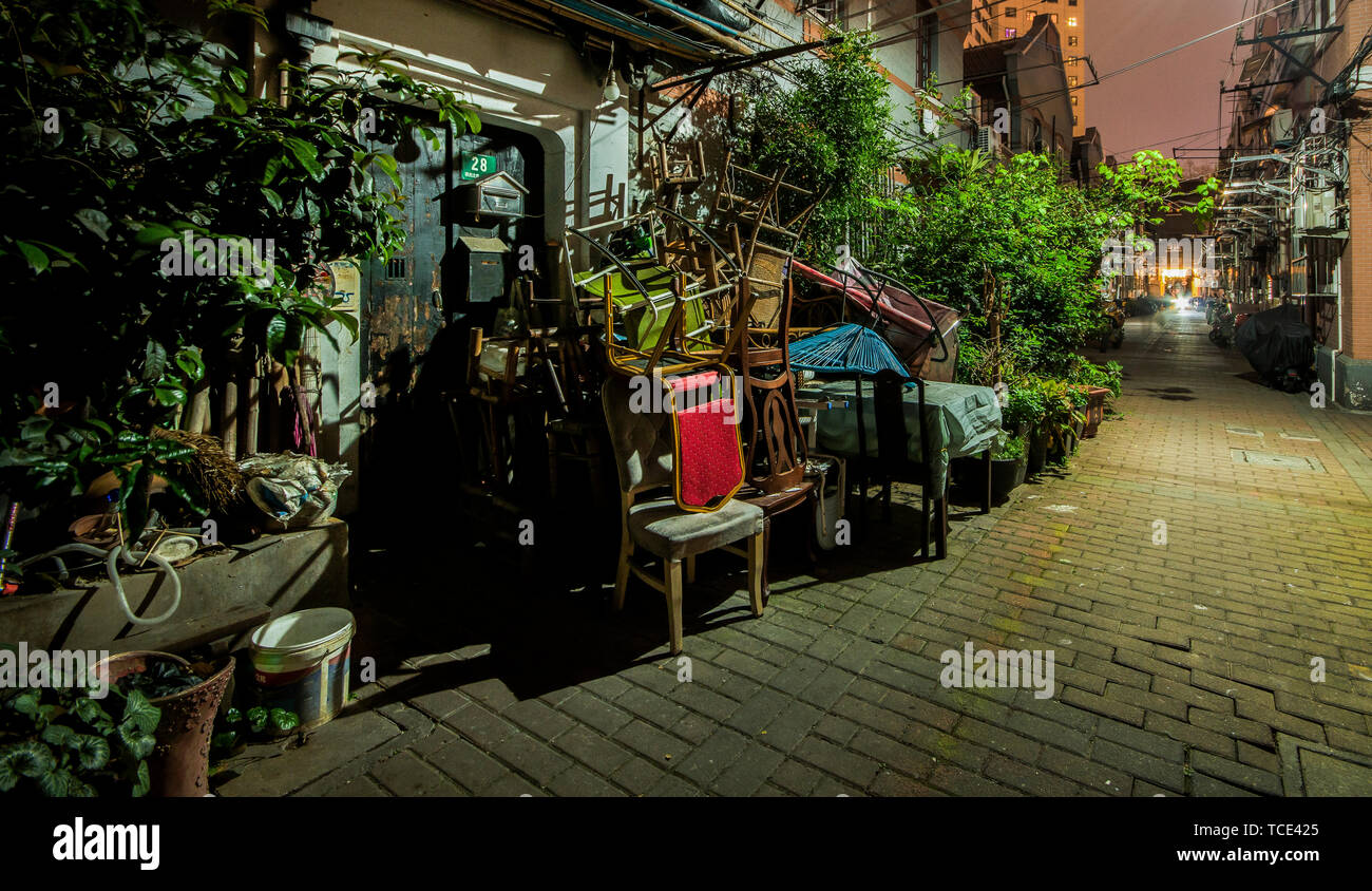 Traditional Shanghai old house with many chairs in front of the door - Stock Image