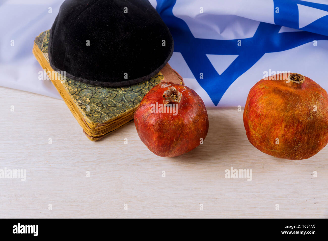 Rosh hashanah Jewish New Year . Traditional holiday symbols pomegranate on a view flat lay background, copy space. - Stock Image