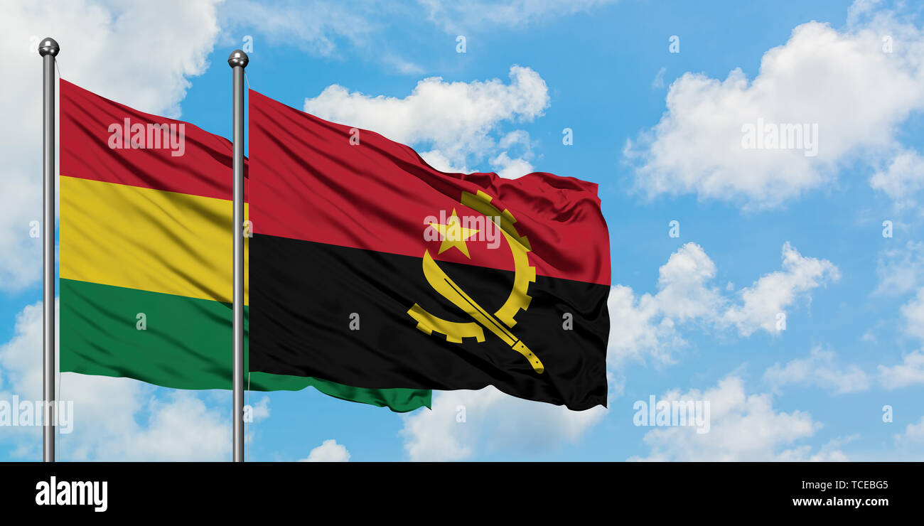 Bolivia and Angola flag waving in the wind against white cloudy blue sky together. Diplomacy concept, international relations. - Stock Image