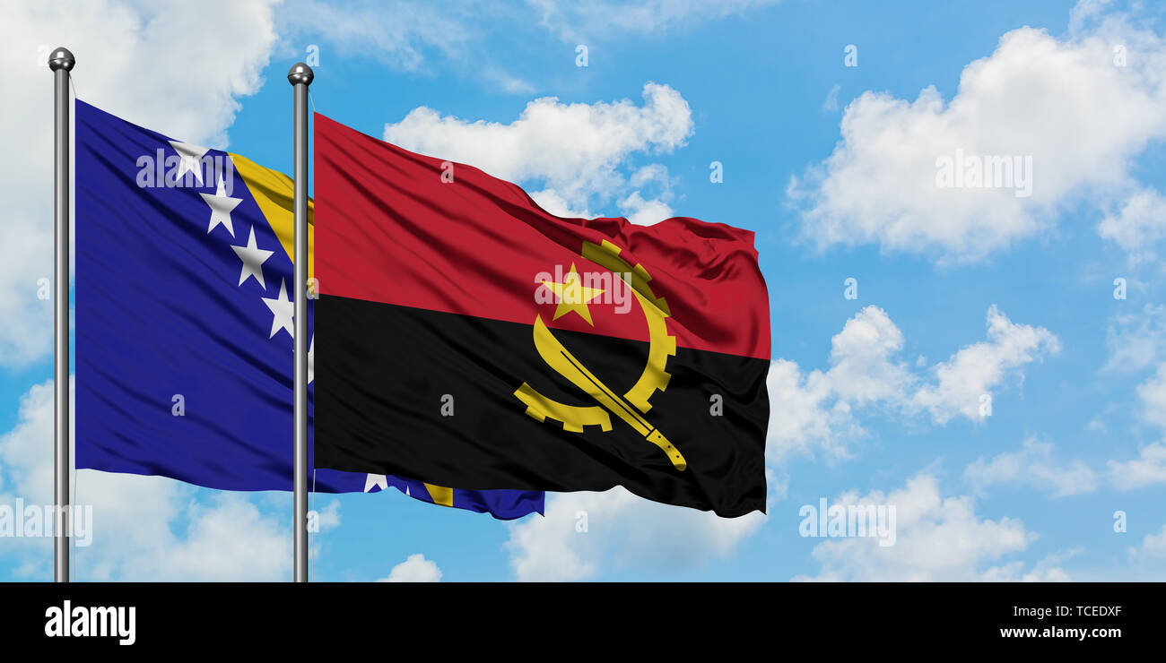 Bosnia Herzegovina and Angola flag waving in the wind against white cloudy blue sky together. Diplomacy concept, international relations. - Stock Image