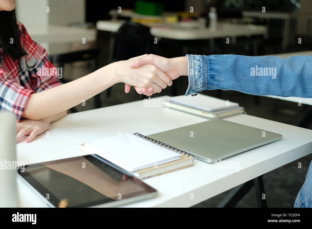 asian girl teenager friends shaking hands for startup project