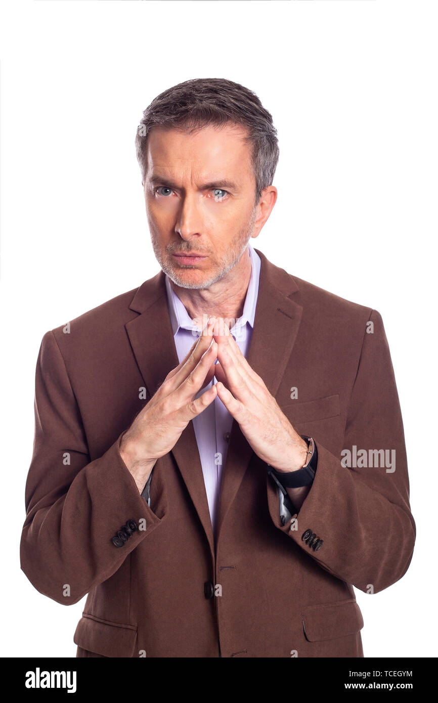 Middle aged bearded businessman on a white background wearing a brown jacket.  The mature man looks like a secretive or dishonest business executive. - Stock Image