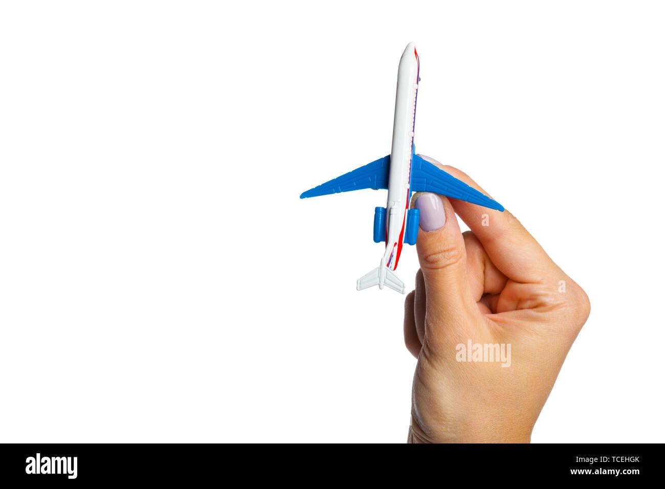 hand holding airplane toy model isolated on white background - Stock Image