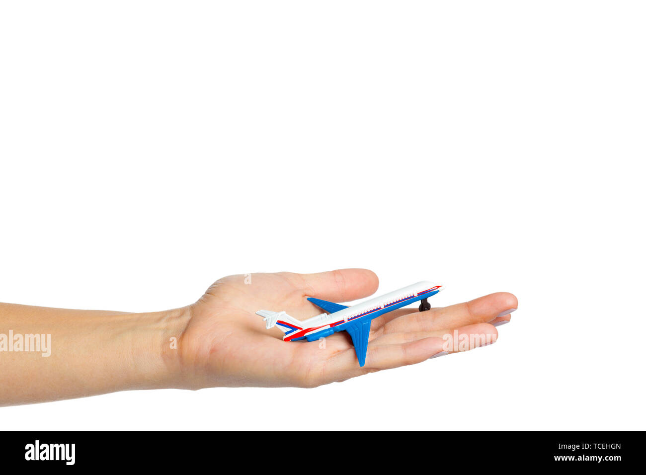 hand holding airplane toy model isolated on white background - Stock Image