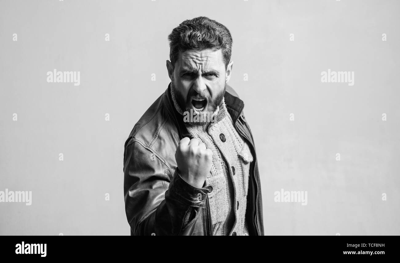 Overwhelmed with emotions. Shouting mature man screaming. Man brutal bearded hipster shouting face. Shouting and threaten violence. Threatening gesture fist. Aggression concept. Man shouting loudly. - Stock Image