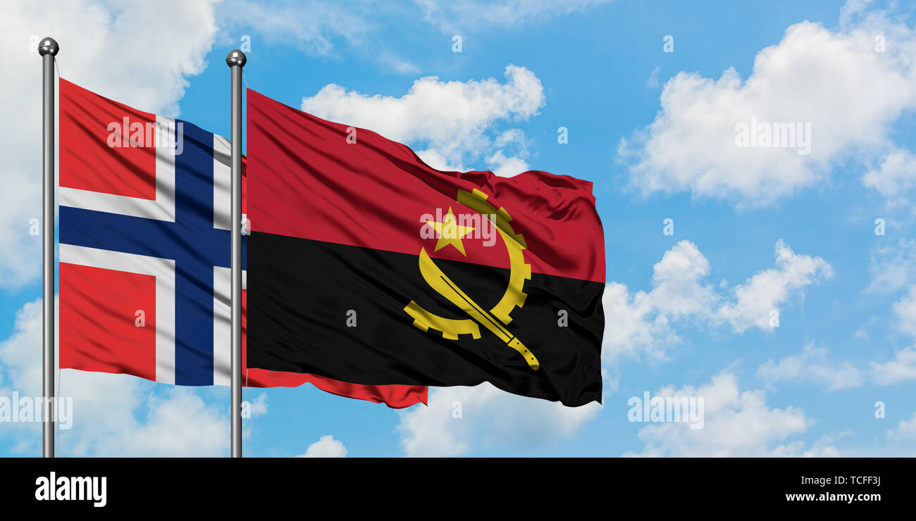 Bouvet Islands and Angola flag waving in the wind against white cloudy blue sky together. Diplomacy concept, international relations. - Stock Image