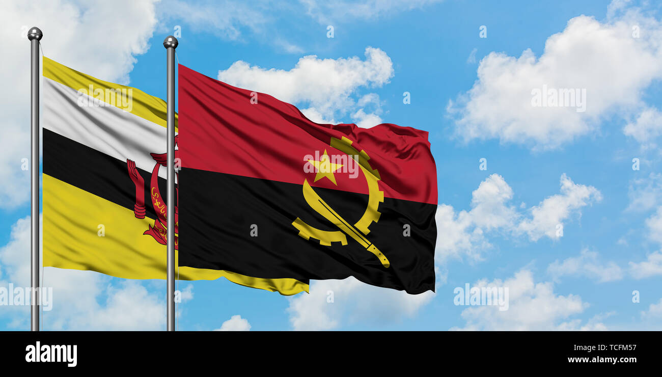 Brunei and Angola flag waving in the wind against white cloudy blue sky together. Diplomacy concept, international relations. - Stock Image