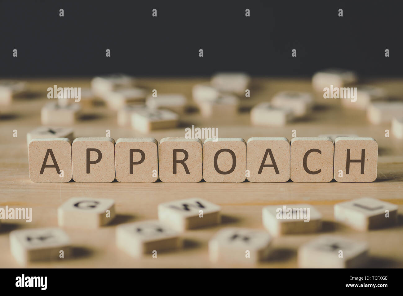 selective focus of word approach made of cubes surrounded by blocks with letters on wooden surface isolated on black - Stock Image