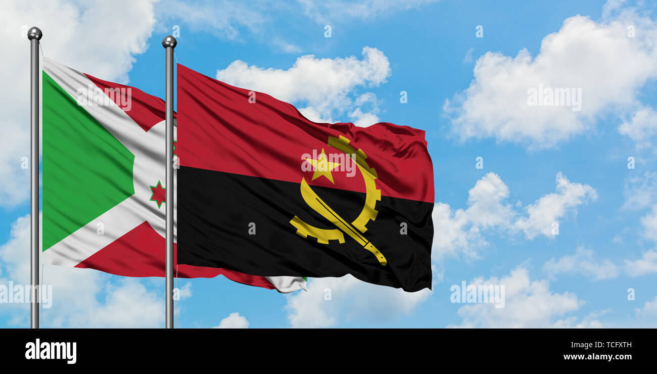 Burundi and Angola flag waving in the wind against white cloudy blue sky together. Diplomacy concept, international relations. - Stock Image