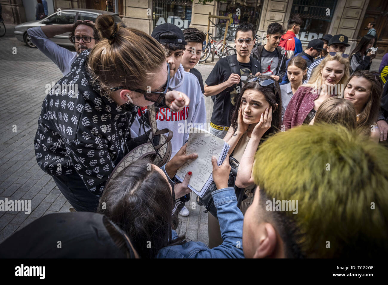 Barcelona, Catalonia, Spain. 7th June, 2019. A group of young people prepare to buy the new Adidas sneaker at the reseller store.The German manufacturer of sports shoes Adidas has launched the limited edition of the Yeezy Boost 350 sports shoe model designed by rapper Kanye West. The limited production of this model has made many young people crowd in front of stores and resellers to be one of the lucky ones. Credit: Paco Freire/SOPA Images/ZUMA Wire/Alamy Live News - Stock Image
