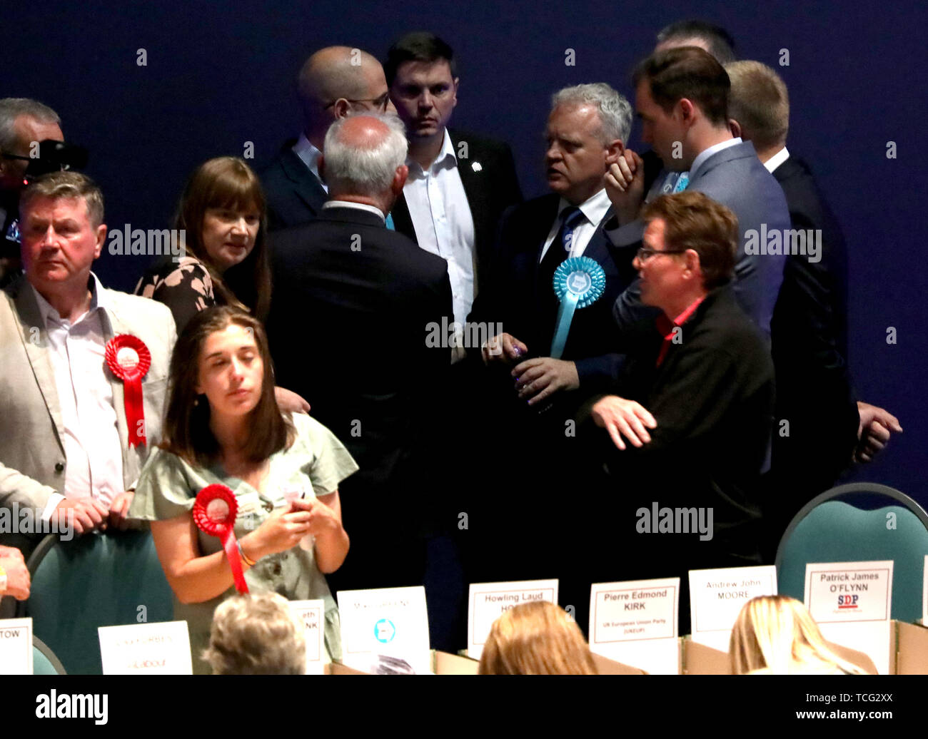 Peterborough, UK. 07th June, 2019. Mike Greene (Brexit Party candidate) huddles with his supporters before the results announcement, when Lisa Forbes (Labour Party Candidate) became the  new Member of Parliament for Peterborough, beating Mike Greene (Brexit Party candidate) into second place and Paul Bristow (Conservative Party candidate) was third. The by-election was held in Peterborough today after disgraced MP Fiona Onasanya was removed from her post as Peterborough MP when over 19,000 signed a recall petition, following her court appearance over a speeding ticket, and her spell in jail. P Stock Photo